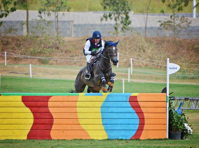 Phillip Dutton and Mighty Nice over the final fence. Photo by Jenni Autry.
