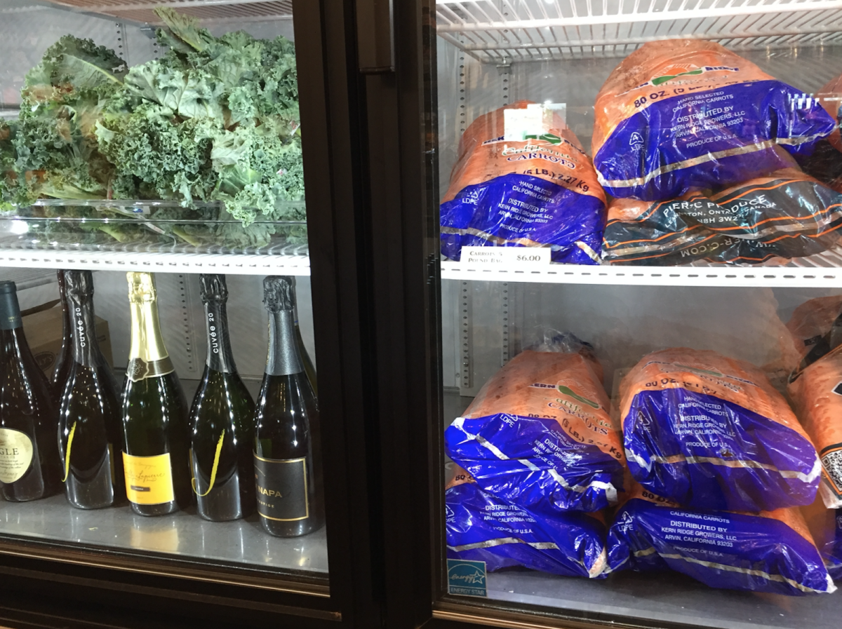 Available for purchase in the general store: kale, champagne, giant bags of carrots. Photo by Leslie Wylie.
