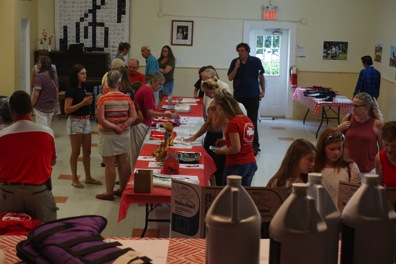 Jessica Phoenix supporters place their bids on silent auction items