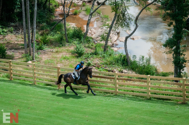 Eric Dierks and Magical Monte gallop by the river at TIEC. Photo by Leslie Threlkeld.