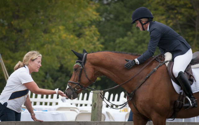 "Fran Robinson, a member of the Lord Willing Syndicate, congratulates ""Liam"" and Allison Springer after winning the CIC*-A division. Photo by Leslie Threlkeld."