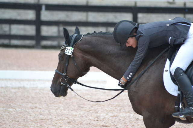 What it's all about! Jr. Training rider Hayden Jones gives Ragtime Blues a big hug after their dressage test. Photo by Leslie Wylie.