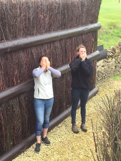 Libby Head and Hannah LoChiatto stand at Cottesmore Leap for scale. Photo by Katherine LoChiatto.