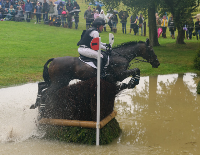 Libby Head and Sir Rockstar negotiate the Trout Hatchery at Land Rover Burghley Horse Trials  Photo by Nico Morgan