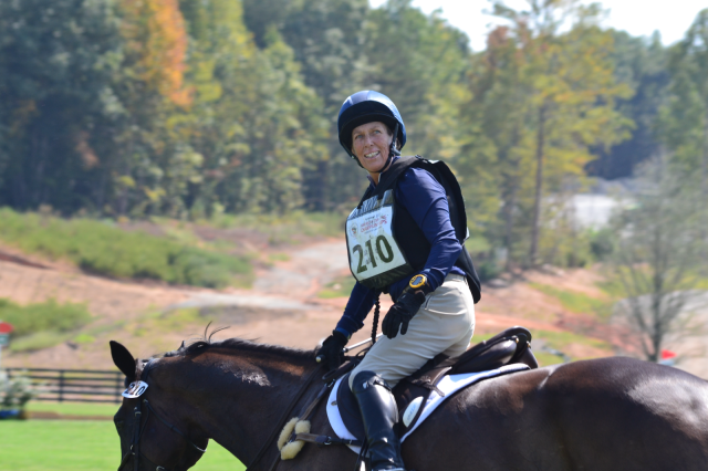 Local favorite Beth Perkins got a big cheer at the cross country finish after her Training Horse ride on Handsome Harry. Photo by Leslie Wylie.