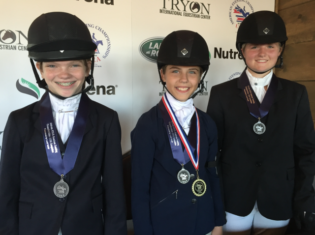 Congrats to the top three finishers in the Broadstone Jr. Beginner Novice 14 and Under division! #1 - Annabelle Kress and Batteries Not Included, #2. Mackenzie Lea and The Man in Black, #3. Chloe Johnson and DaVinci. Photo by Leslie Wylie.