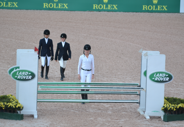 Jr. Novice riders walk their show jumping course. Photo by Leslie Wylie.