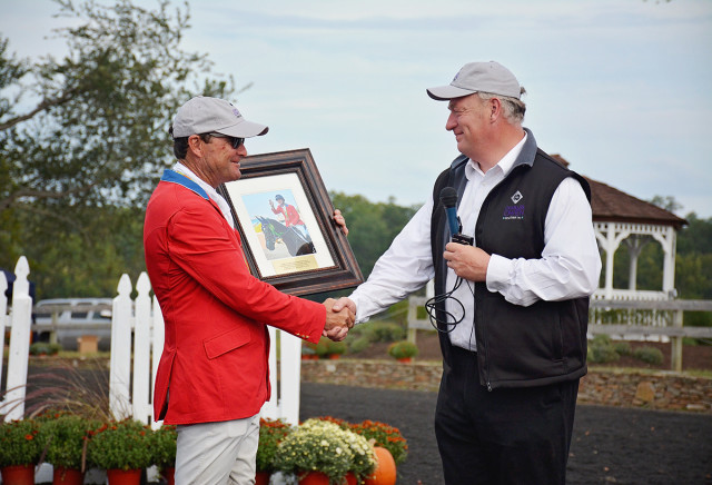 Roy Burek presented Phillip Dutton with a plaque and photo from the victory gallop in Rio. Photo by Jenni Autry.