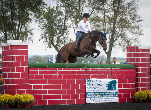 This young rider's position over a five foot wall is about as good as it gets! Oh, and she's riding bareback. Photo by Leslie Threlkeld.