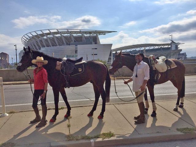 Valerie and Peter with Primitivo and Solar stopping to pose for a picture outside the brand new Cincinnati Bengals Stadium. The stadium holds special memories for Valerie as she sang the National Anthem there the night it opened. Photo by Samantha Clark.