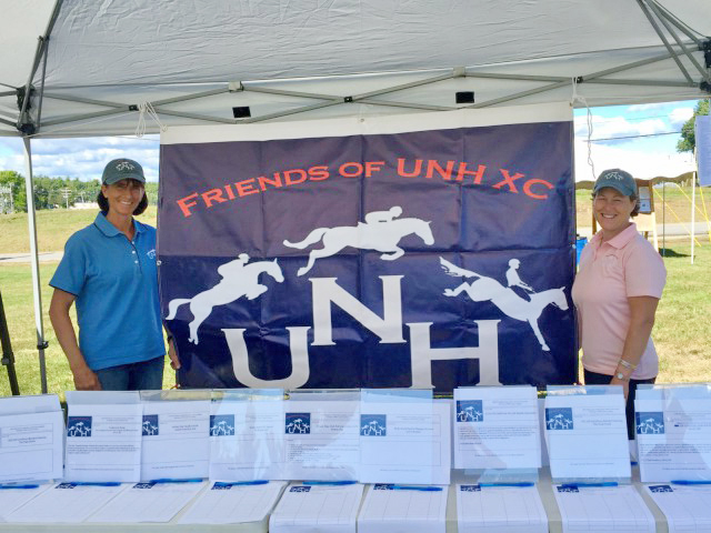 Rachel Greene-Lowell and Julie Howard with their silent auction setup at the UNH Fall Horse Trials. Photo by Abby Powell.