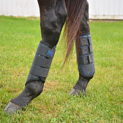 Mia models the Majyk Equipe Color Elite XC Boots in Azure Blue. Photo by Jenni Autry.