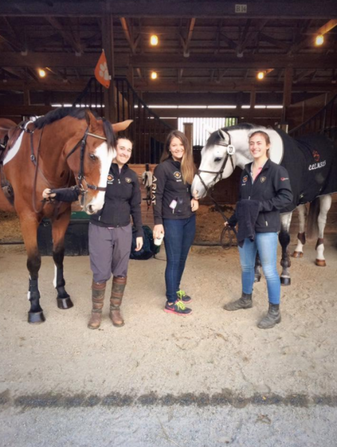Team members Erica Wind, Molly Micou, and Linda Limeri helping hold horses as the other riders prepare for show jumping. Photo courtesy of Clemson Eventing Team.