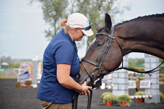 Happy and super groom Emma Ford share a moment at Plantation Field during a ceremony honoring his Olympic performance. Photo by Jenni Autry.
