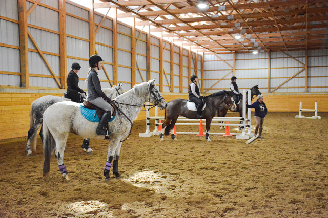 Riders listening to Jackie's instruction getting ready to ride their course. Photo by Miranda Akins.
