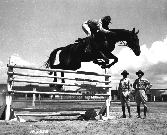 Sgt. John Hill riding Jumping Dan Ware, Ft. Benning, Ga., July 25, 1941. Public domain.