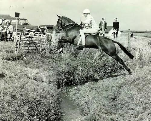 Caption: How ditches should be jumped! Riding my favourite pony Charlie's Aunt at the Pony Club Championships in 1967 on Cheltenham racecourse. Best boy that year was Richard Walker on Plucky Pasha, who won Badminton two years later. My brother Charlie was second and I was third. Photo courtesy of William Micklem.
