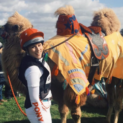 The author contesting a camel race ... guess which country? Photo courtesy of Tilly Berendt.