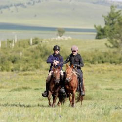 Ed Fernon and Barry Armitage cross the finish line together. Julian Herbert/Mongol Derby