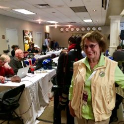 Carol working in the media center at Rolex. Photo courtesy of the Atkins family.