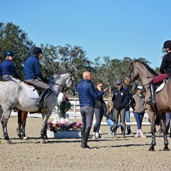 USEF Emerging Athlete Coach Leslie Law debriefs the riders after the first jumping lesson of the day. Photo by Jenni Autry.