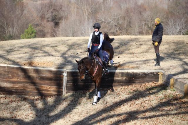 Jill Treece successfully negotiates the down bank while Boyd looks on. PC: Mark Treece