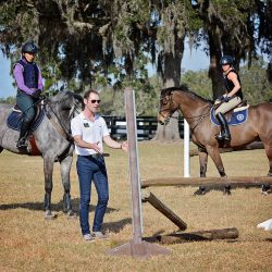 Joseph showing the Novice group the correct angle for jumping a corner. Photo by Jenni Autry.
