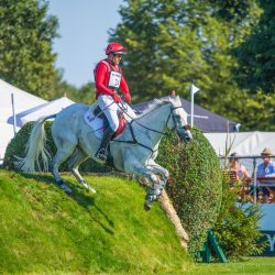 Paul Tapner and Bonza King of Rouge make easy work of the International arena's varied terrain to take the win in the MS Amlin Eventers' Challenge. Photo courtesy of the All England Jumping Course, Hickstead.