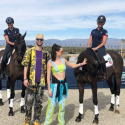 Frankie Thieriot Stutes and Tamie Smith make friends with the locals at the 4xFAR Festival in Coachella, California. Photo courtesy of Tamie Smith.