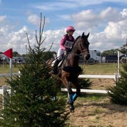 Ellouise Bragg makes her way out on cross country with her dad, Alex Bragg's, former 5* horse, Zagreb. Photo via Team Bragg Eventing on Facebook.